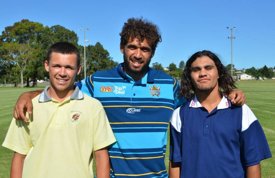 Former Gold Coast Titans Tyronne Roberts-Davis (centre) alongside Ethan Thompson (left) and Ivan Madden.