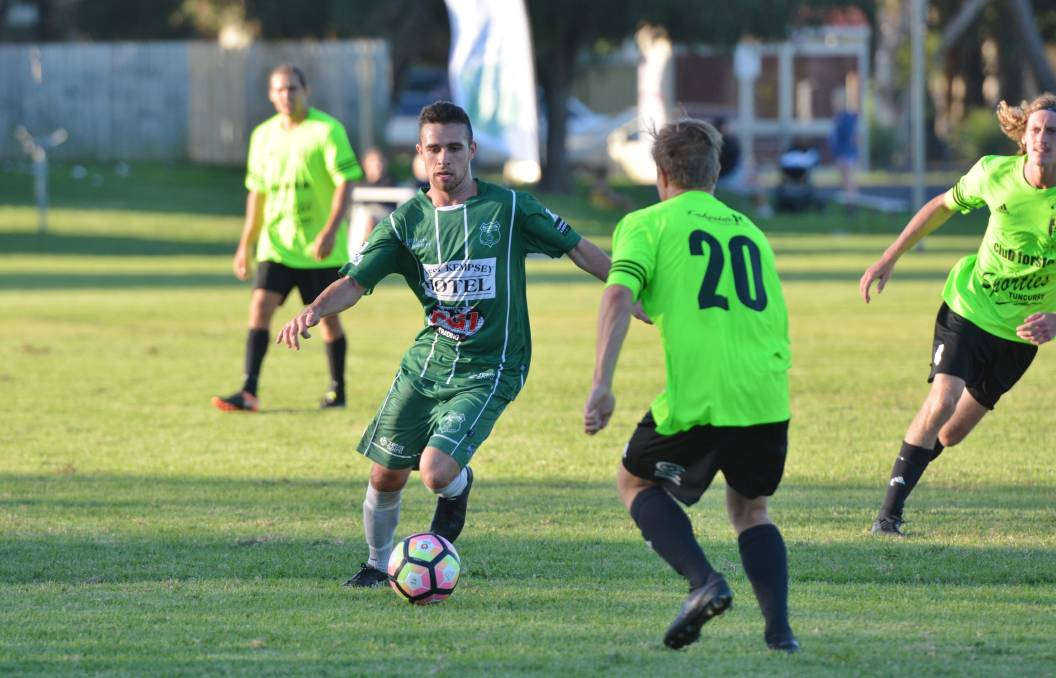 Agile: Kempsey Saints' Tristan Smith looks to take on a defender in their match against Wallis Lake. Photo: Penny Tamblyn.